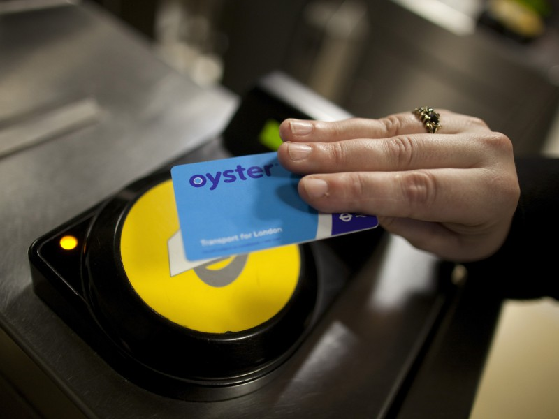 A passenger uses an oyster card to exit Liverpool Street station after traveling on a London Underground tube train in London, U.K., on Thursday, June 7, 2012. U.K. Sport, a provider of state funding to the country's Olympics program, has recruited about 100 companies and 25 academic institutions to adapt industrial technology for use in sports, according to Scott Drawer, the agency's head of research and innovation. Photographer: Simon Dawson/Bloomberg via Getty Images
